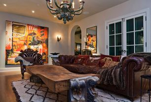 Eclectic Living Room with French doors, Chandelier, Wall sconce, Arched doorway, Butler Specialty Accent Chair