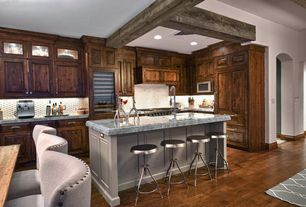 Contemporary Kitchen with Kitchen island, Undermount sink, built-in microwave, Glass panel, Breakfast bar, Penny Tile