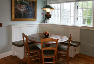 Craftsman Dining Room with Hardwood floors, Window seat, Pendant light