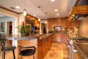 Contemporary Kitchen with double oven range, limestone tile floors, Farmhouse sink, folding door, Glass panel, can lights