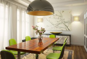 Contemporary Dining Room with can lights, Built-in bookshelf, Wall sconce, Standard height, Pendant light, Hardwood floors