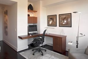 Contemporary Home Office with Standard height, Built-in bookshelf, Hardwood floors