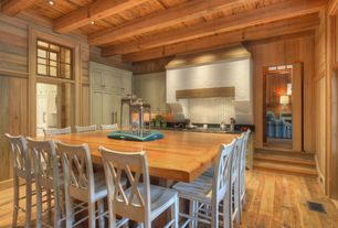 Rustic Kitchen with full backsplash, Transom window, Custom hood, can lights, Inset cabinets, Hardwood floors, Breakfast bar