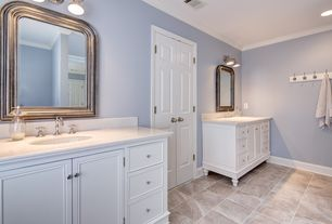 Traditional Master Bathroom with wall-mounted above mirror bathroom light, Inset cabinets, Complex Granite, Vinyl floors