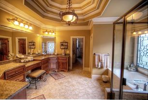 Mediterranean Master Bathroom with Simple granite counters, Undermount sink, Simple Granite, Bathtub, Raised panel, Shower