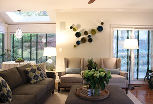 Traditional Living Room with Pendant light, Wall sconce, Standard height, Crown molding, sliding glass door, Ceiling fan