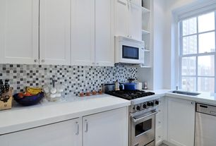 Modern Kitchen with L-shaped, Flat panel cabinets, Undermount sink, Corian- Designer White, Flush, Ceramic Tile