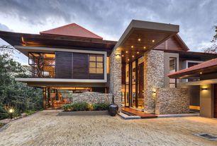 Contemporary Exterior of Home with Stone exterior