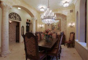 Mediterranean Dining Room with Crown molding, Columns, Chandelier, flush light, sandstone tile floors, Wall sconce