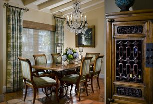 Traditional Dining Room with Chandelier, Exposed beam, terracotta tile floors, High ceiling