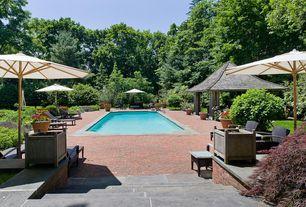 Traditional Swimming Pool with exterior brick floors, Gazebo, Pathway, Lap pool