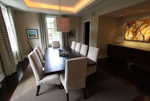 Contemporary Dining Room with can lights, double-hung window, Laminate floors, Built-in bookshelf, Standard height