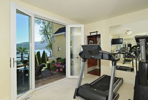 Traditional Home Gym with Carpet, French doors, flush light