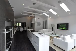 Contemporary Great Room with Pendant light, Exposed beam, French doors, Carpet, Hardwood floors