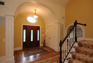 Traditional Entryway with Cathedral ceiling, flush light, Hardwood floors, picture window, Glass panel door, French doors