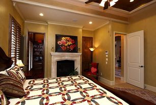 Eclectic Guest Bedroom with flush light, Cement fireplace, Carpet, Ceiling fan, Wall sconce