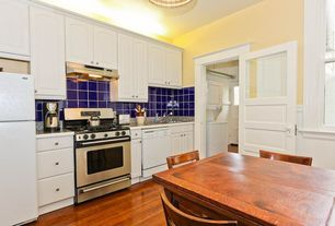 Traditional Kitchen with Formica counters, Breakfast nook, Raised panel, One-wall, Hardwood floors, Ceiling fan, Glass Tile