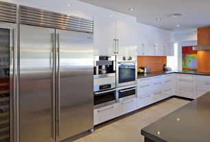 "Contemporary Kitchen with Flush, Subzero 48"" built-in side-by-side refrigerator/freezer bi-48s/s, Galley, European Cabinets"