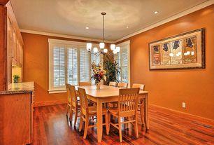 Eclectic Dining Room with Hardwood floors, Crown molding, Chandelier