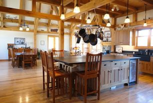 Craftsman Kitchen with Farmhouse sink, Framed Partial Panel, single dishwasher, Concrete counters, sliding glass door