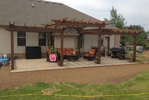 Traditional Patio with Trellis, exterior stone floors, French doors, Outdoor kitchen