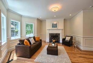 "Traditional Living Room with Wainscotting, Hardwood floors, West Elm Henry 86"" Sofa, Pottery Barn - Irving Leather Armchair"