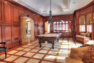 Traditional Game Room with can lights, picture window, Crown molding, Hardwood floors, Pendant light, Window seat