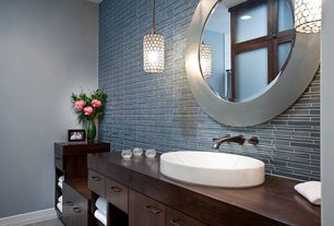 Contemporary Master Bathroom with Vessel sink, European Cabinets, Overstock quoizel 'ariella' 1-light mini-pendant, Flush