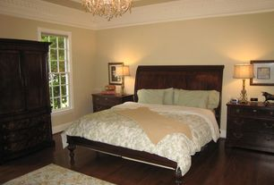 Traditional Master Bedroom with Chandelier, double-hung window, Crown molding, Standard height, Hardwood floors