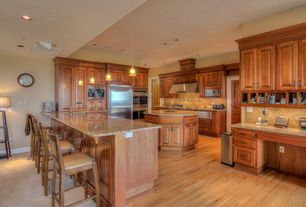 Traditional Kitchen with Pendant light, Wall Hood, Breakfast bar, Simple granite counters, Kitchen island, electric cooktop