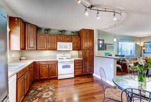 Traditional Kitchen with Simple Granite, Raised panel, Hardwood floors, Breakfast bar, Eat in kitchen, Breakfast nook
