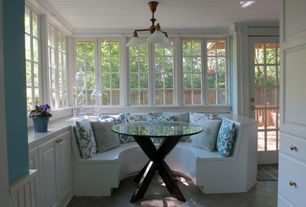 Cottage Dining Room with Daltile Natural Hues Mushroom Ceramic Floor & Wall Tile, Built-in bookshelf, limestone tile floors
