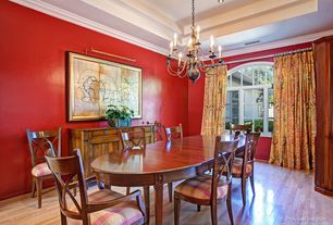 Traditional Dining Room with Crown molding, Arched window, Laminate floors, High ceiling, Chandelier