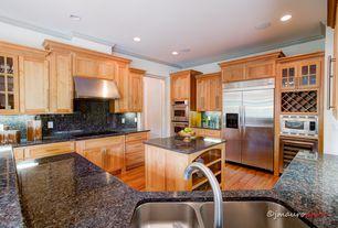 Craftsman Kitchen with Ceiling molding, Flat panel cabinets, Custom wine storage, Flush, Glass panel, Simple Granite