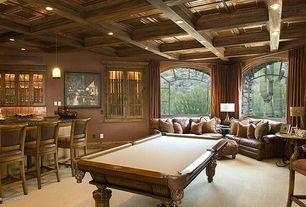 Traditional Game Room with Concrete tile , Pendant light, Box ceiling, Arched window, Exposed beam, Arch window