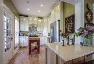 Country Kitchen with full backsplash, Kitchen island, double-hung window, Hardwood floors, Flush, Farmhouse sink, Wall Hood