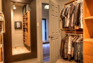 Traditional Closet with limestone tile floors, simple granite floors, White interior 6-panel door, Built-in bookshelf