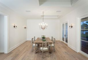 Rustic Dining Room with Chandelier, Standard height, Wall sconce, French doors, Crown molding, Hardwood floors