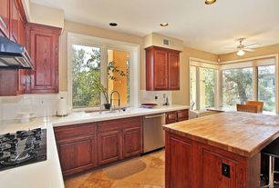 Traditional Kitchen with Wood counters, Raised panel, Ceiling fan, Wall Hood, dishwasher, Simple marble counters, L-shaped