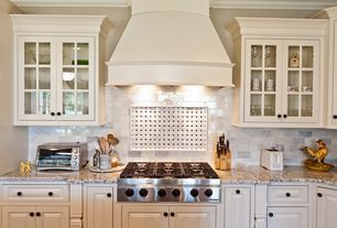 Traditional Kitchen with Stone Tile, Complex granite counters, Raised panel, Inset cabinets, Slate Tile, Glass panel