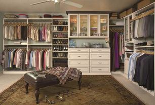 Traditional Closet with Paint, Tufted leather bench, Glass cabinet, Standard height, Carpet, Custom closet storage, Area rug