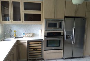 Contemporary Kitchen with Ceramic Tile, Undermount sink, L-shaped, Gray mosaic backsplash, Tall pantry pullout, flush light