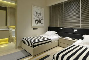 Contemporary Guest Bedroom with can lights, Laminate floors, Standard height