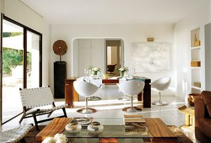 Great Room with International design nepture leather side chair in white, Built-in bookshelf, Rustic Wood Disc Sculpture