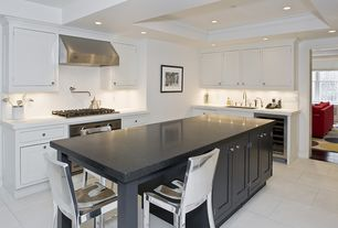 Contemporary Kitchen with Wine refrigerator, Standard height, can lights, Inset cabinets, full backsplash, stone tile floors