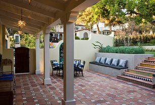 Mediterranean Patio with Raised beds, exterior tile floors, exterior terracotta tile floors