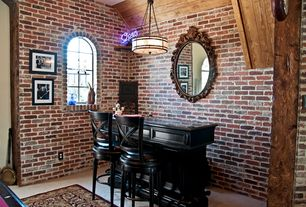 Eclectic Bar with Arched window, interior brick, Pendant light, High ceiling, Concrete floors