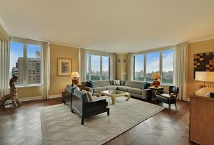 Modern Living Room with Bernhardt Elka Chair, Paint, Casement, Built-in bookshelf, Hardwood floors, Landmark Rug 9x12