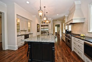 Traditional Kitchen with Oak - Antique 2 1/4 in. Solid Hardwood Strip, Kitchen island, Custom hood, Undermount sink, U-shaped