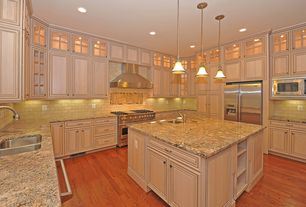 Traditional Kitchen with Standard height, Built In Refrigerator, Framed Partial Panel, Wall Hood, Stone Tile, Paint, U-shaped